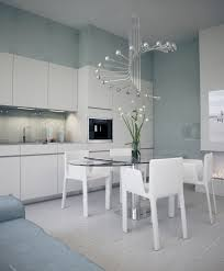 upgrading your kitchen lighting and style using chandeliers spiral kitchen chandelier design over glass top dining table and 4 white armchairs in contemporary white kitchen ideas upgrading