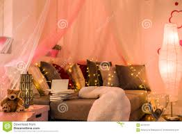 fairy lights in teen bedroom stock photo image 64720707