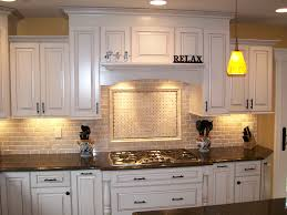 sink faucet kitchen backsplash ideas with white cabinets pattern