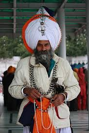 Turban   Wikipedia Wikipedia An Akali Singh wearing many Aad Chands in Amritsar and holding prayer beads