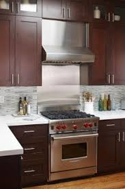 Kitchen Backsplash Cherry Cabinets by A Contemporary Small Kitchen Makeover Shaker Cabinets Basements