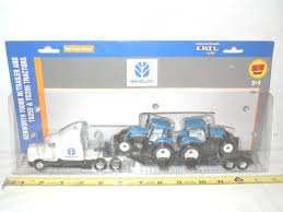new kenworth semi new holland tg255 u0026 tg285 kenworth semi hauling set by ertl 1 64th