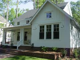 just love this new farmhouse style home with batten board siding
