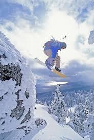 diamond peak lake tahoe nevada usa man snowboarding in mid air diamond peak lake tahoe nevada usa man snowboarding in mid air
