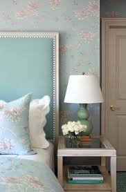 absolutely love the headboard and the floral print on both the bed