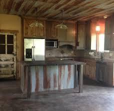 rustic kitchen with old door for pantry door custom made island
