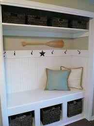 Storage Bench With Hooks by Closet Turned Into A Bench With Storage For Shoes And Hooks For