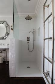 best 25 half wall shower ideas on pinterest bathroom showers open walk in shower subway tiles glass partition towel rack