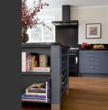 Gray Color Schemes For Kitchens by Deep Grey Cabinetry U0026 Island W Black Tops On Wall Cabinetry And