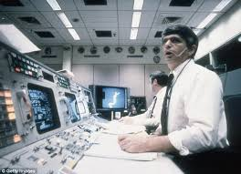 Frederick Gregory  foreground  and Richard O Covey  spacecraft communicators at Mission Control in Daily Mail