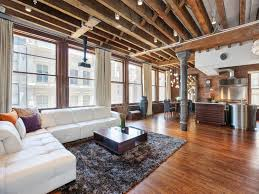 Exposed Beam Ceiling Living Room open plan apartment with exposed wood beams and iron columns