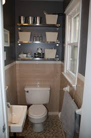 peach tile bathroom with grey walls plus fun shiny shelves in the