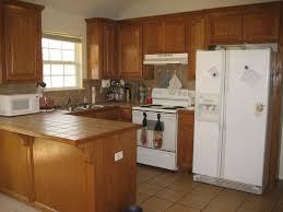 kitchen stainless steel refrigerator stone backsplash glass