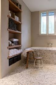 bathroom round wooden tub and wall and also robe hanger for