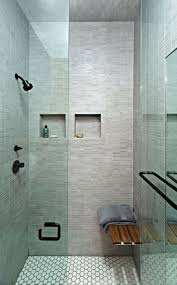 walk in shower with glass doors and grey white tiling picture