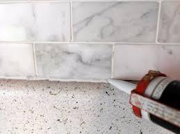 How To Install A Marble Tile Backsplash HGTV - Carrara tile backsplash
