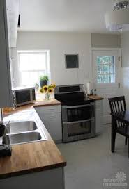 Retro Metal Kitchen Cabinets by White Metal Cabinets With Wood Countertop Learning To Love My 50s