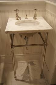 Tiny Powder Room Ideas Undermount Sink With A Marble Top On Console Legs Remodeled