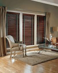 living room with curtains and faux wood window blinds spruce up