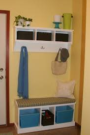 white corner entry bench with triple open storage under wall