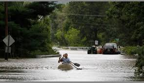 Flood worries and some relief in Irene     s wake   Lubbock Online         of a canoe with his friends Sean Lefebvre and Ed Lefebvre on floodwaters caused by Hurricane Irene  Sunday  Aug            in Lincoln Park  N J   AP