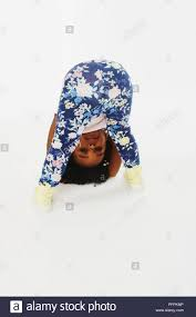 Little girls bent over|Young girl in dress bending over a chair Stock Photo - Alamy