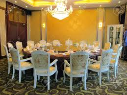 restaurant dinning room with big table closet and chandelier