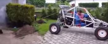 buggy driver tries to pull bush out of the ground plant fights