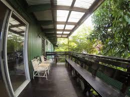 sprawling mid century hawaiian plantation home with swimming pool