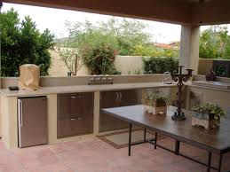 backyard outdoor kitchen idea with pergola and stone kitchenette