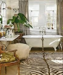 chocolate zebra rug with powderpuff vanity stool bath