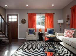 living room gray sofa white bookcases brown ceiling fans black