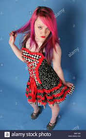 full length portrait of a beautiful teen with long pink hair