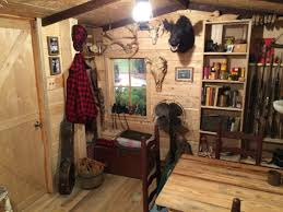 man turns unused basement room into a log cabin replica make
