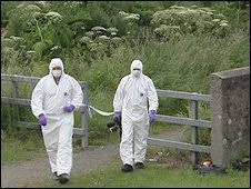 Forensic investigators at the murder scene in July 2009. Marek Muszynski\u0026#39;s body was found in a laneway at Upper Edward Street - _46049225_newrydeath
