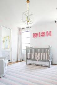 white and pink nursery with gray crib transitional nursery