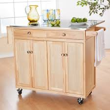 natural maple wood island with metal countertop having expandable