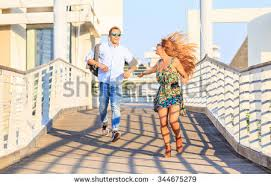 Happy Hipster Couple On Holiday Having Stock Photo               Shutterstock Happy hipster couple on holiday having fun and enjoy the time together  Dating young best