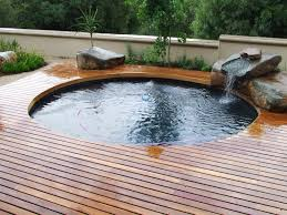 cool design ideas with varnished wooden deck round shape green