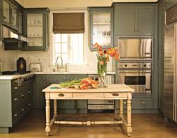 green color kitchen cabinets solid brown wooden countertop lower