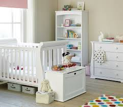 baby bedroom ideas with white baby crib and 5 tier open shelving