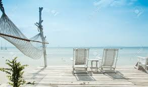 Luxury Beach Chair White Beach Chair And Hammock Facing Ocean Stock Photo Picture