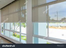 roll blinds on windows sun does stock photo 706162630 shutterstock
