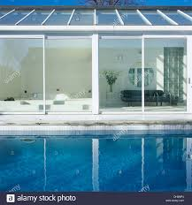 Modern Conservatory Sitting Room Seen Through Sliding Glass Doors Of Modern