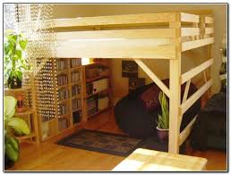 rustic loft bed with stairs with bookshelf at the bottom