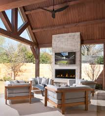 outdoor fireplace with tv patio traditional with beadboard ceiling