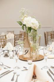 diy wine bottle centerpiece with hydrangeas and blush roses table