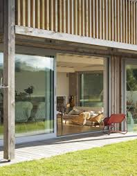 Wood Slat by Wood Slat Home With Utterly Open Living Spaces