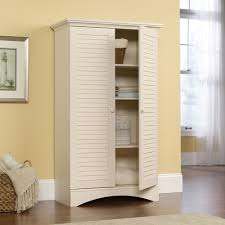 furniture tall white wood bookcase with shutter pattern swinging