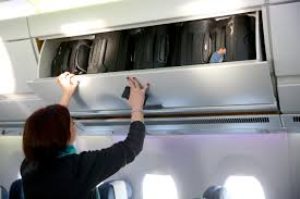 United Airline Baggage by United Airlines Will Begin Charging To Use Overhead Bins In 2017